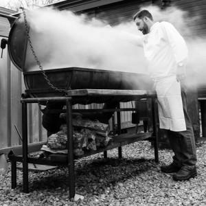 Helsinki Hudson chef Hugh Horner oversees smoker